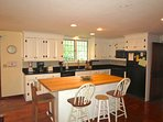 The kitchen is good sized with a handy island for prep or a casual meal