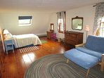 The last bedroom has 1 queen and 2 convertible twin beds that can be folded up for use as chairs