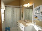 Full bath is closest to master bedroom and also has a vaulted ceiling, adding a sense of space.