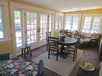 The sunroom is off the the living room and has french doors that open to the deck