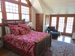 Master bedroom has doors to a private balcony