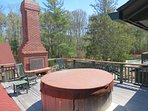 The private balcony has a hot tub and outdoor fireplace