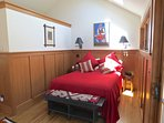 The guest studio has private access and this queen bed