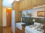 The guest studio has this small but well equipped kitchen