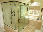 Master bathroom with walk-in shower and a tub