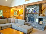 Living room with a nice stone fireplace.