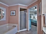 Master bath with Jacuzzi tub and large stand in shower