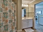 Second bath adjoins second bedroom and opens to living space