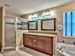 Master bath with Jacuzzi tub, stand up shower, and double sinks