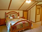 The bedroom with a queen bed
