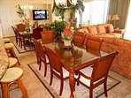 The coastal inspired dining table seats 6 with extra seating at the bar on swivel bar stools