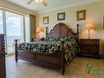 The Captain's Master Suite has a luxurious king-sized bed with luxury linens and a floor to ceiling sliding door for...