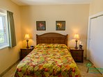 The cozy Tropical Dream Room has a luxury queen bed and a large closet.