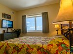 The Tropical Dream Room has a picture postcard view of the beach and the strip.  There's a flat screen TV, too!