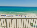 View from the balcony. Emerald waters and sugar white sand keep our guests coming back year after year!