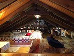 Sleeping loft with one double and one twin bed.