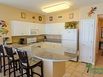 Spacious, well equipped kitchen with plenty of cabinets for storage and an ocean view, makes cooking fun! There's a...