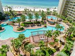 The largest pool in Panama City Beach!  The beachfront pool complex has a lagoon pool, a huge hot tub, a tiki bar, a...