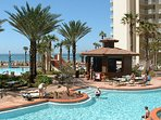 The world class pool deck complex has a tiki bar and grill for drinks and snacks.