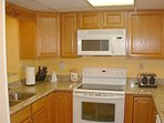 The well equipped gourmet kitchen has beautiful appliances, granite counter tops and honey oak cabinets with lots of...