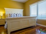 The Coastal Breeze Master Suite is decorated in coastal cottage inspired style.  With a luxurious king-sized bed with...