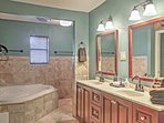 Enjoy soothing bubble baths in this luxurious bathroom.