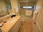 another bathroom with shower tub