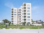 View of Palm House Condominiums from the beach.