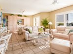 The oceanfront living room features a flat screen TV, DVD, VCR and access to the patio.