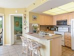 Ocean view, fully equipped kitchen with seating for 2 at the kitchen counter.