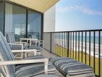 Comfortable seating on the balcony.