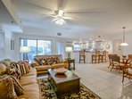 Tastefully decorated living room with Tommy Bahama style decor, 60' flat screen HDTV and DVD.