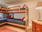 3rd bedroom with 2 sets of bunk beds(4 beds) and flat screen TV.