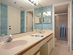 Master bath with his/her sink and walk-in shower.