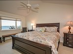2nd floor master bedroom with views that look off onto the ocean
