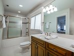 Master bathroom with tub and spacious sink area