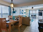 Ocean view dining room with seating for 6 with additional seating at the kitchen counter for 4.