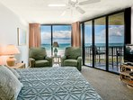 Wake up and see the dolphins play in the oceanfront master bedroom with floor-to-ceiling windows, king sized bed, flat...