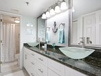 Private master bath with walk-in shower and his/her sinks.