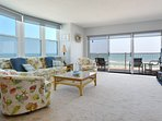 Oceanfront living room with flat screen TV, DVD, VCR and sofa sleeper.