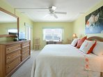 Oceanfront master bedroom with king size bed, TV and private bath.