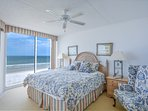 Oceanfront master bedroom with king size bed, TV, DVD, desk, access to the balcony and private bath.