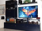 Entertainment Center with 50' HDTV, DVD and DVR. Movies and Stereo