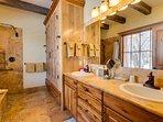 En suite master bathroom with double vanities