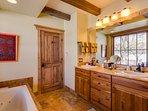 En suite bathroom with double  vanities