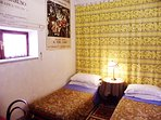 Printed art reproduction on all walls in this bedroom