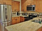 Kitchen with beautiful custom cabinets, granite counters and stocked with all the gadgets you need to make it like home!