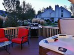 Large deck with comfortable seating, Grill and  8 person Bullfrog Hot Tub