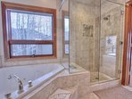 Grand Master Private Bath with Roman Tub, Stone shower and Dual Vanities