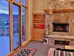 Living room with stone fireplace and private deck on main level - Park City Tranquility - Park City